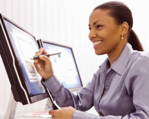 Black Businesswoman with Computer and Cell Phone